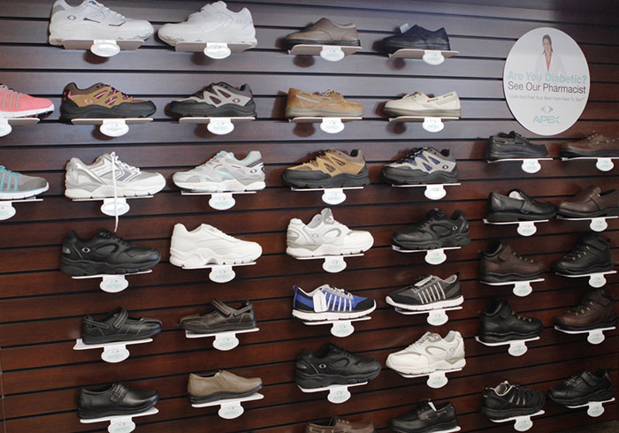 A wall displaying various styles of diabetic shoes