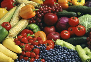 bunch of bananas, berries, tomatoes, corn showing good sources of fiber